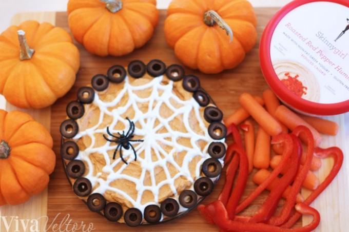 Spiderweb hummus with veggies and pumpkins