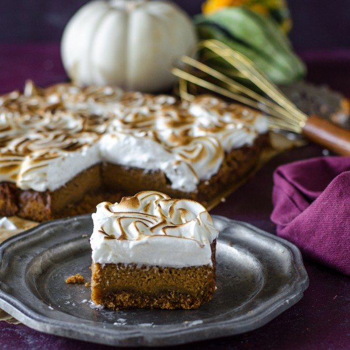 Apple butter pumpkin pie bars on a silver plate