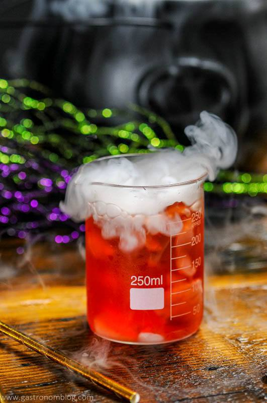 Poisoned apple cocktail in a beaker