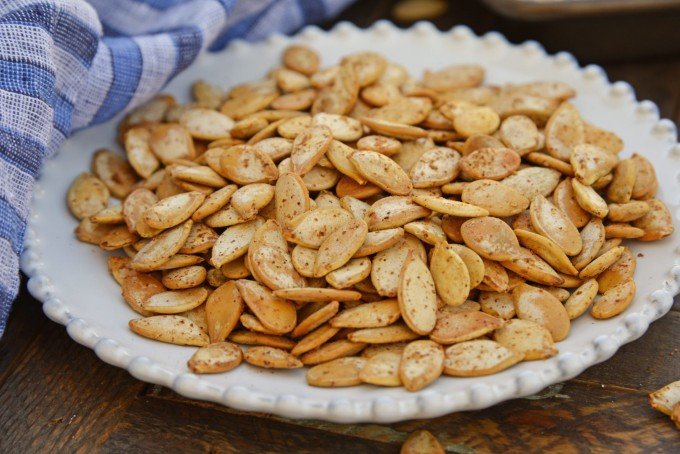 Roasted pumpkin seeds on a white plate