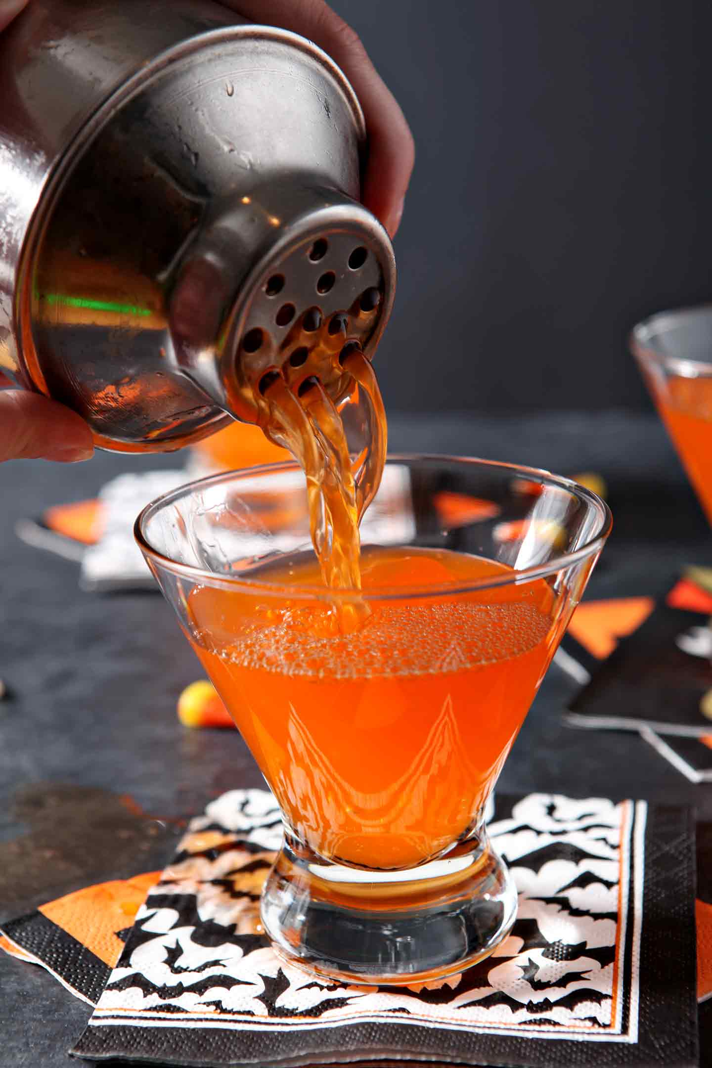Candy corn martini poured into a glass
