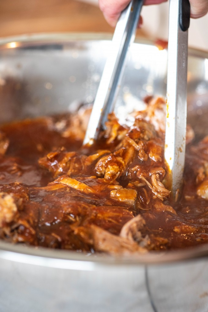Instant Pot pulled pork simmering in BBQ sauce