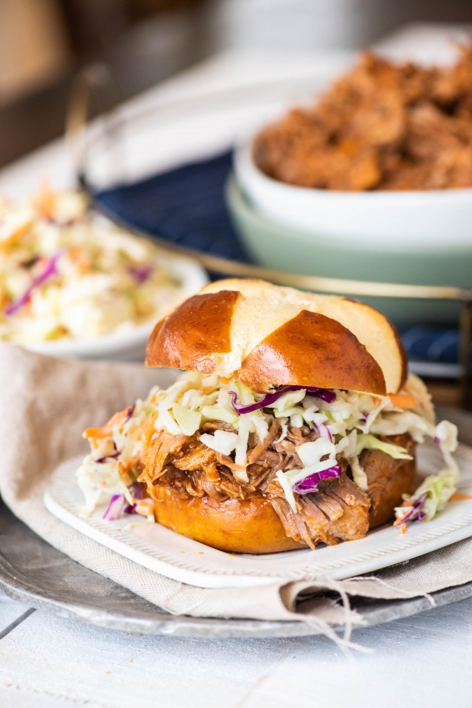 Instant Pot pulled pork sandwich on a white plate