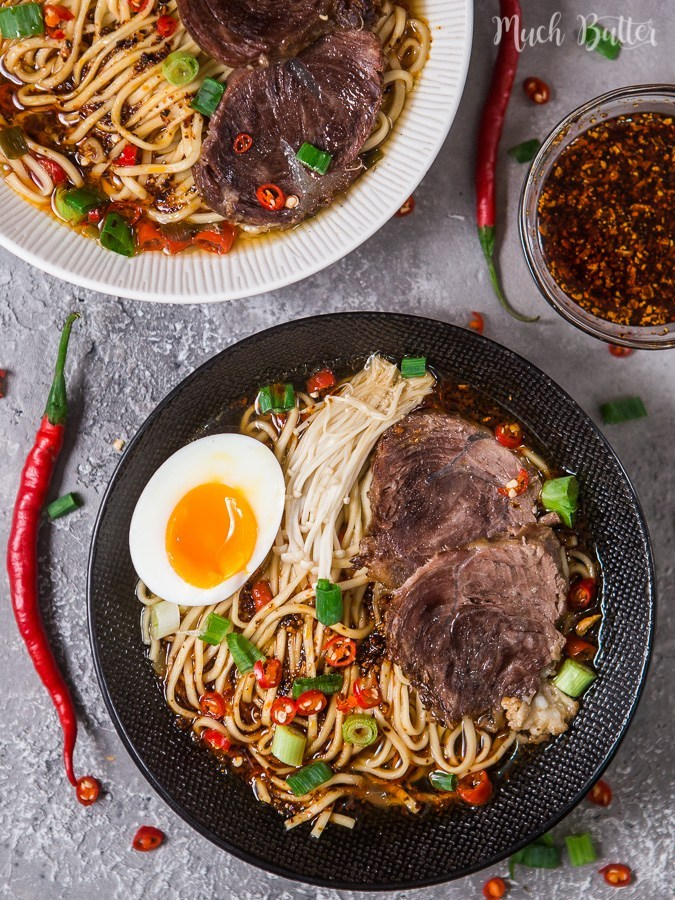 beef ramen topped with scallions and an egg