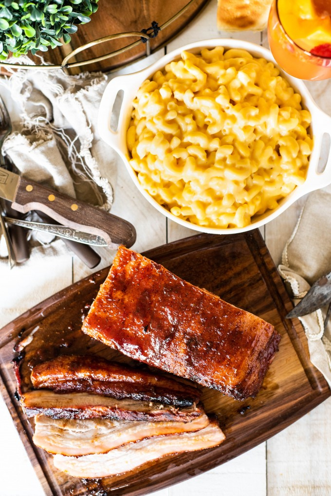 Overhead view of BBQ Smoked Pork Belly with mac and cheese