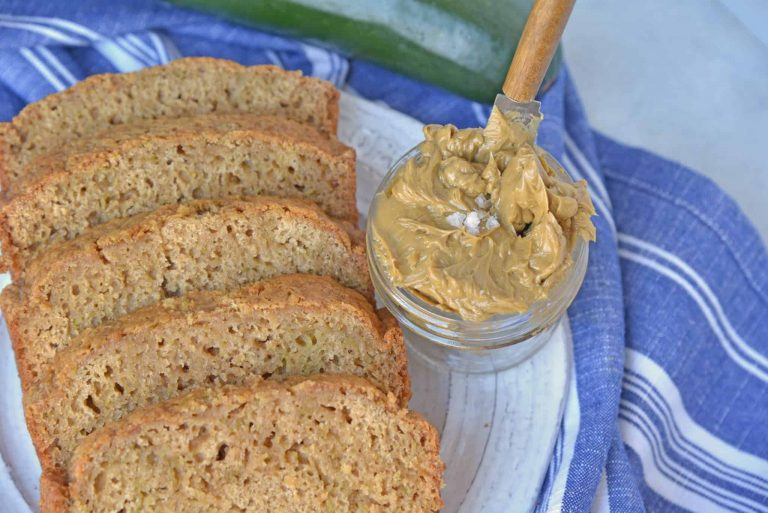 Zucchini bread sliced with butter spread