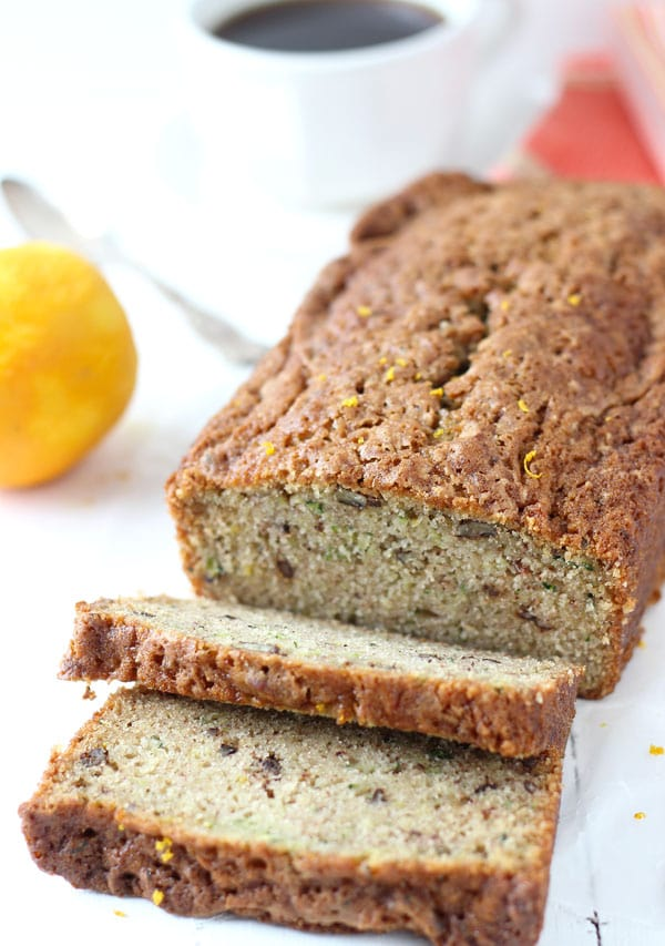 Close up of sliced orange zucchini bread