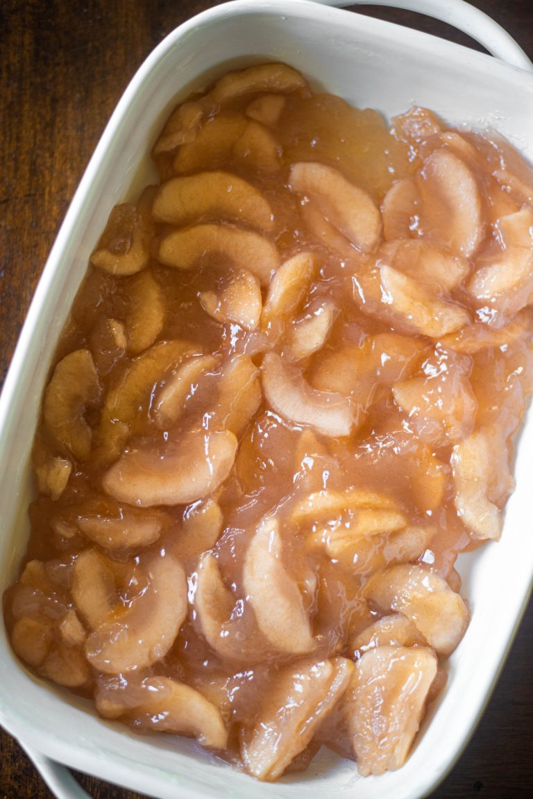 Canned apples in a white baking dish