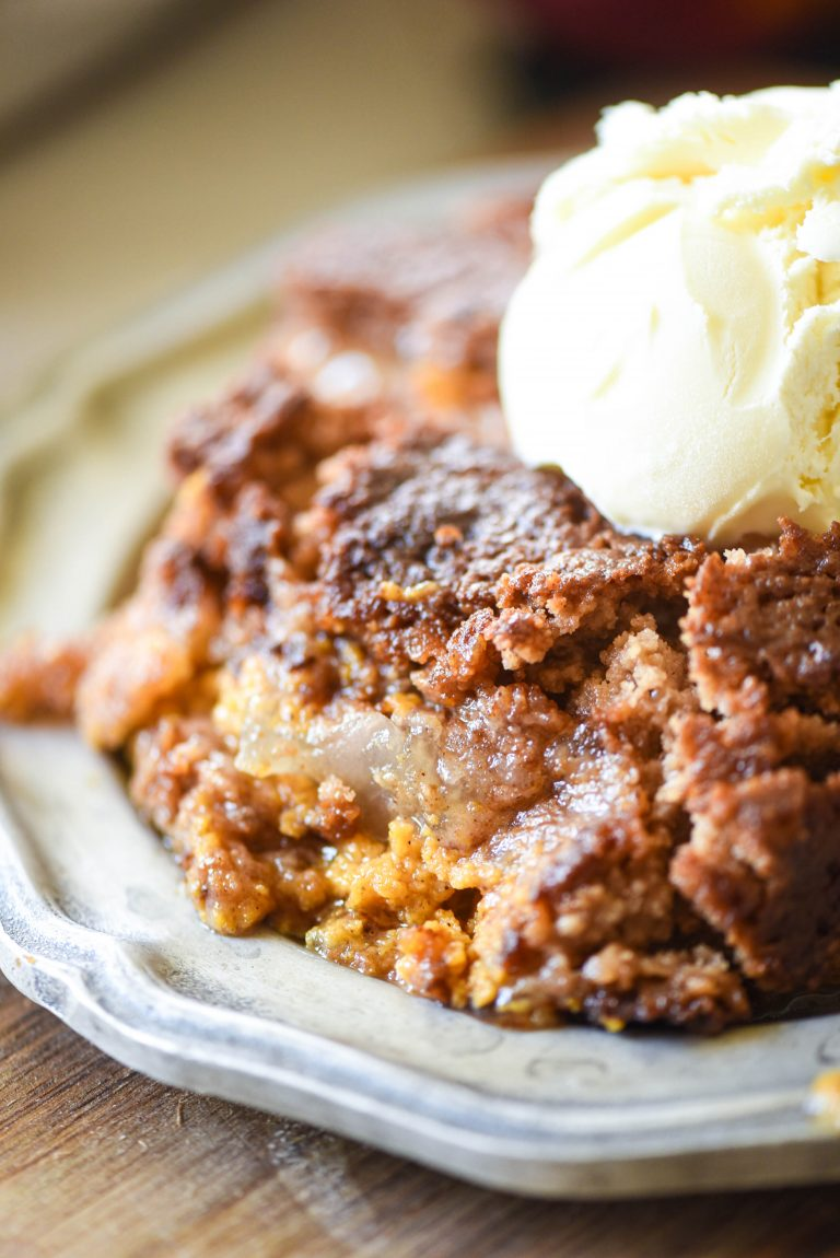 Close up of Apple Pumpkin Dump Cake with a scoop of ice cream on top