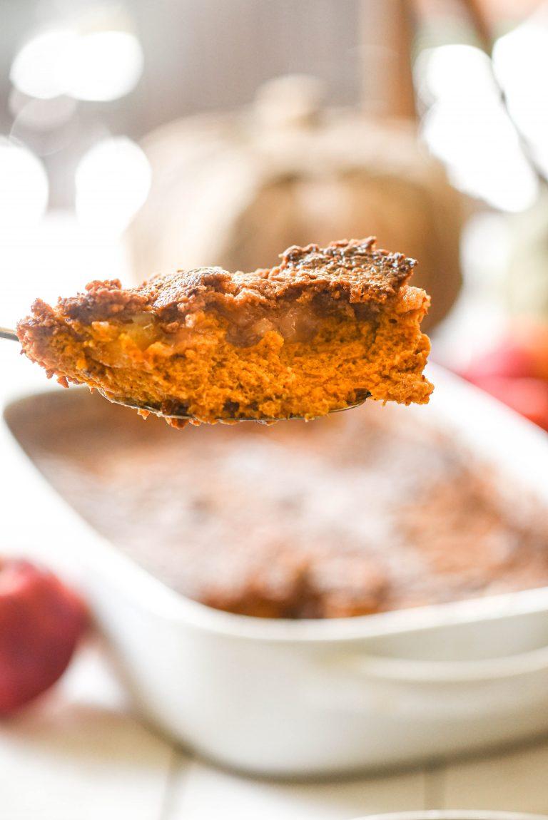 Slice of Apple Pumpkin Dump Cake on a serving spoon