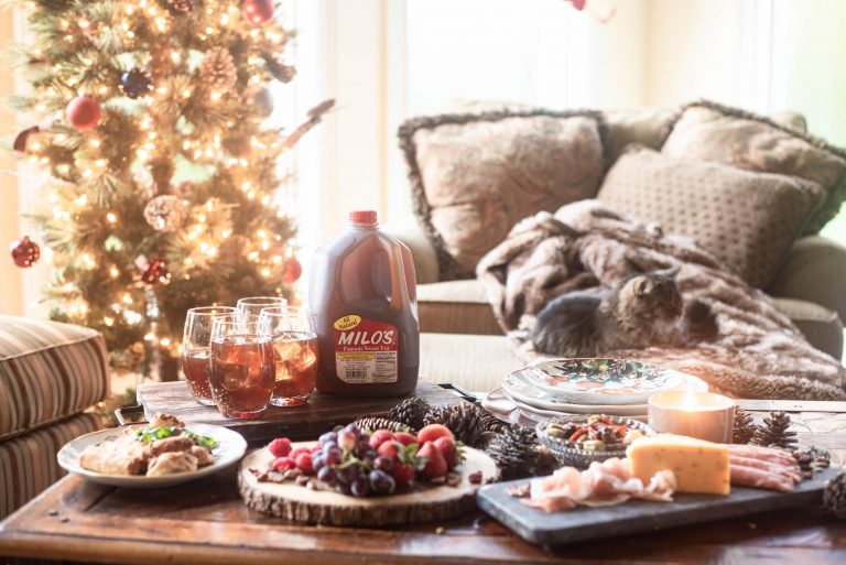 Holiday entertaining appetizers and drinks on a coffee table