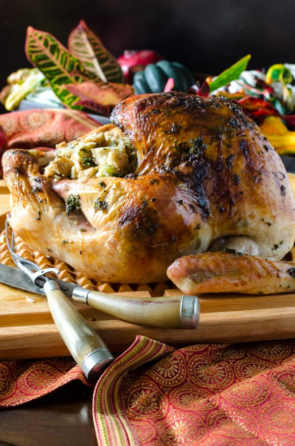 Close up of Herb Roasted Turkey on a cutting board