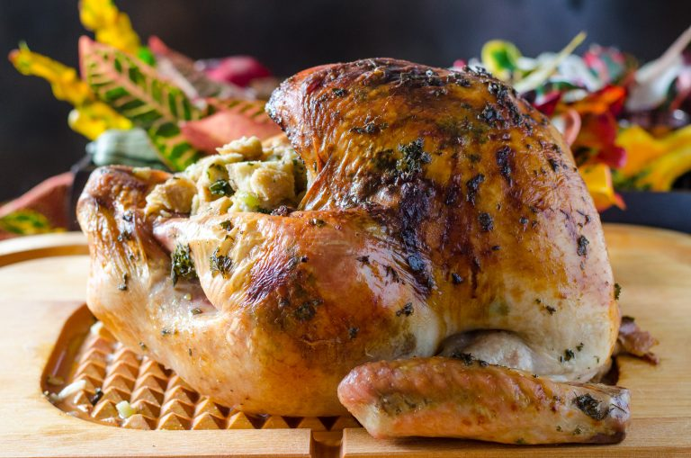 Thanksgiving Herb Roasted Turkey on a cutting board