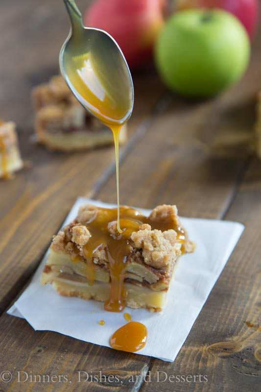 Caramel drizzled onto caramel apple pie bars