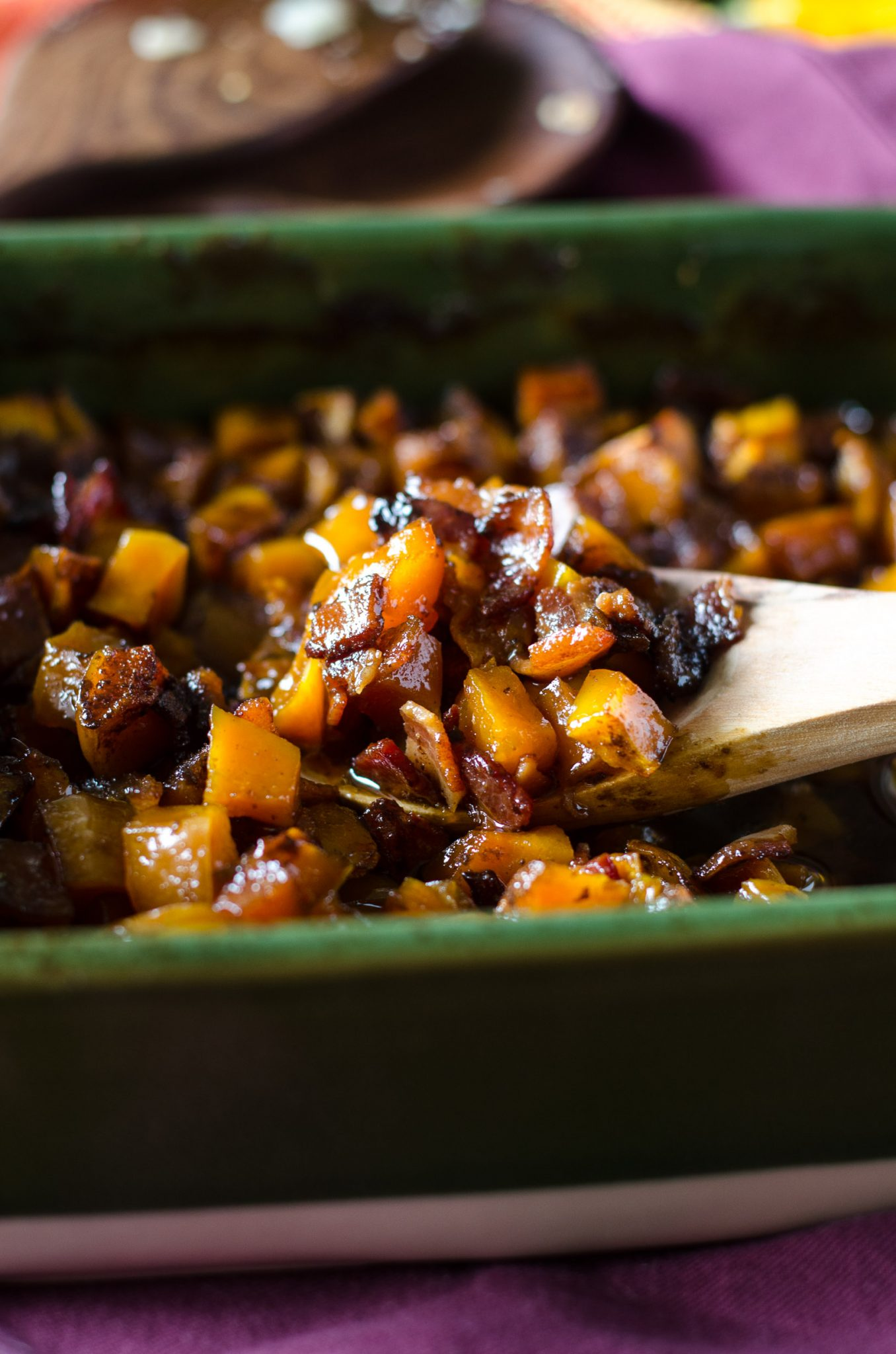 Bourbon bacon brown sugar butternut squash in a green baking dish