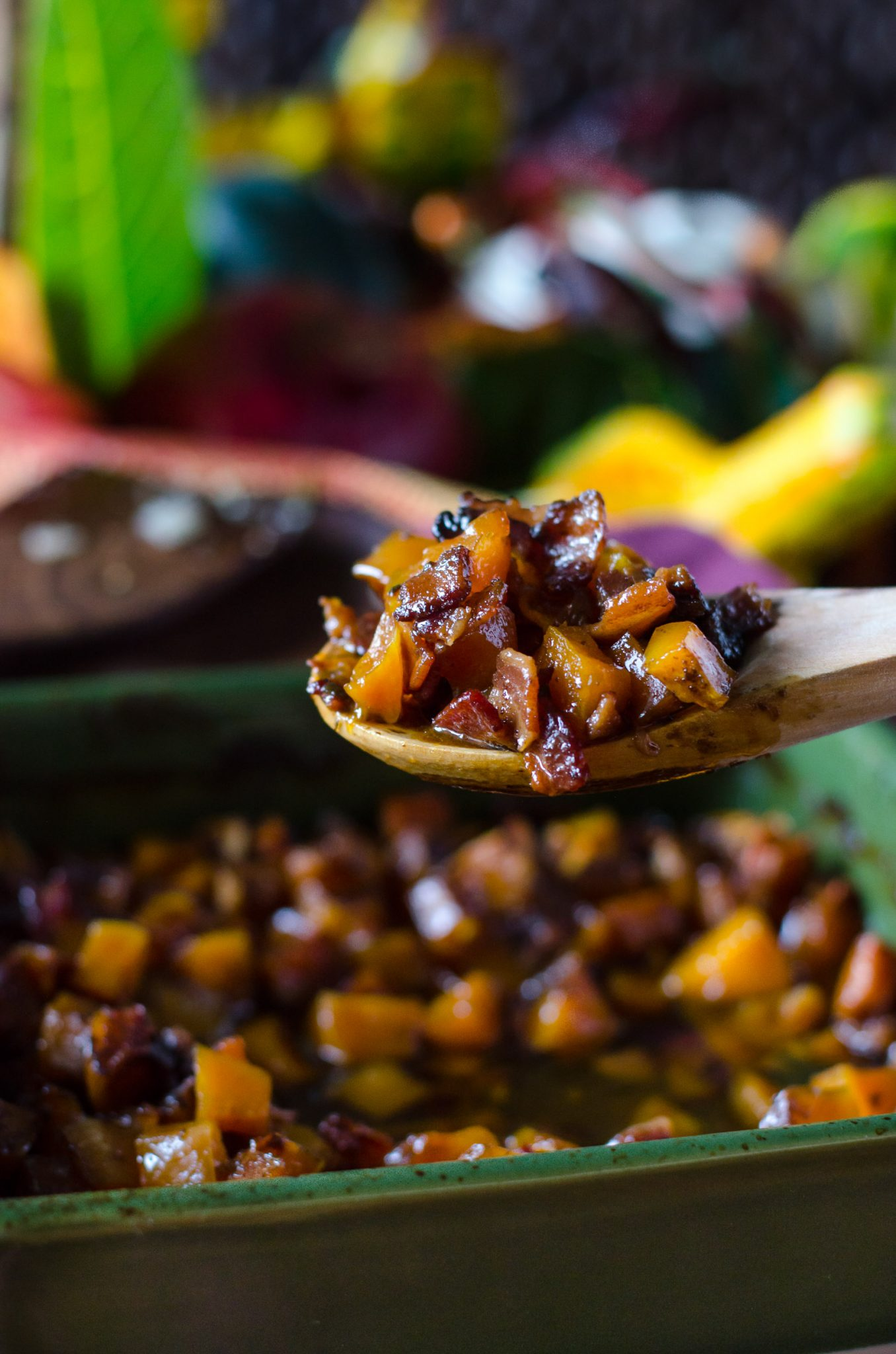 Close up of bourbon bacon brown sugar butternut squash on a wooden spoon