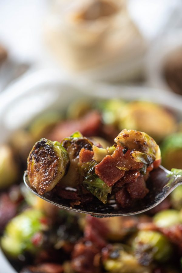 Close up of stovetop brussels sprouts on a spoon